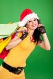 Spaßfrau mit Farbenpaketen Stockfoto