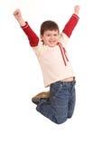 Spaßjunge im Jeans-Hochsprung. Stockbilder
