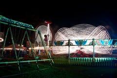 Spaßmesse nachts Stockbild
