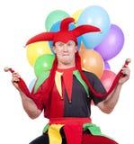 Spaßvogel mit Ballonen Stockfotografie