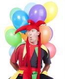 Spaßvogel mit Ballonen Stockfoto
