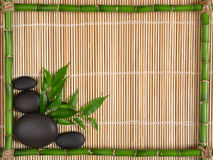 Spa. Bamboo frame ,leaves and stones Stock Photos