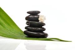 Spa. Stacked zen stones , jasmine flower on zen Stock Image