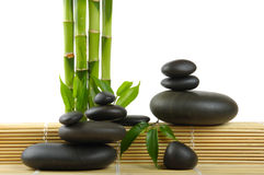 Spa. Bamboo stem ,leaves and stones Stock Photos