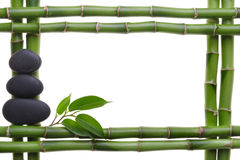 Spa. Bamboo stem ,leaves and stones Royalty Free Stock Images