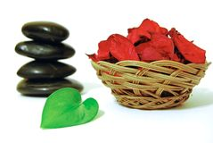 Spa. Stones, red flowers and green leaf on a white background Royalty Free Stock Images