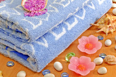 Spa. Spa composition: blue towels, stones, shell and aromatherapy salt Royalty Free Stock Image