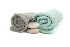 Spa. Towel and stone, isolated on white Royalty Free Stock Photography