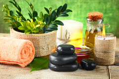 Spa. Oil  stones  for spa and a flower Royalty Free Stock Photography