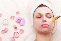 SPA. Applying of soothing mask, young woman getting spa procedures Stock Photography
