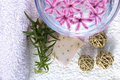 Spa. Lavender soap, towels,  water, and flowers Stock Photo