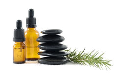 Spa. Stacked of stones with bottle of aromatherapy oil and fresh green leaves Stock Photography