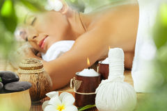 In spa. Portrait of young beautiful woman in spa environment Royalty Free Stock Image
