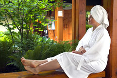 Spa. Woman outside with robe resting and enjoying a spa resource Stock Photos