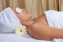 Spa. Woman relaxing with eyepads on eyes at spa Stock Image