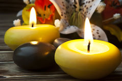 Spa. Burning spa candles with white lily reflection Stock Image