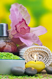 Spa. Setting with candles, flowers, towel and natural salt on wooden table Royalty Free Stock Photo