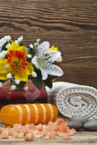 Spa. Setting with flowers, towel and natural soap on a wooden background Royalty Free Stock Photos