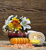 Spa. Setting with candles, flowers, towel and natural salt on wooden table Stock Photography