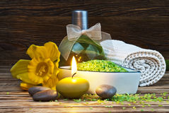 Spa. Setting with candles, flowers, towel and natural salt on wooden table Royalty Free Stock Photos