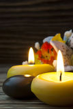 Spa. Burning spa candles with white lily reflection Stock Images