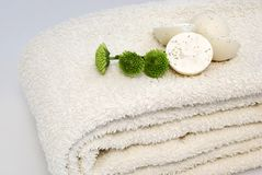 Spa. Natural oil soaps with green flowers on white towel Stock Photos