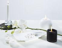 Spa. Candle and white orchid Royalty Free Stock Photo
