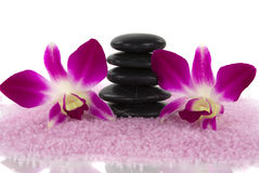 Spa. Aromatic bath salt, healing pebbles and exotic orchids Royalty Free Stock Photo
