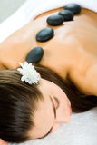 Spa. Attractive woman getting a stone massage in a spa