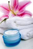 Spa. Lilly flower on white towel  with face cream Stock Photo