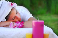 Spa. A young girl doing spa in the garden Royalty Free Stock Photography