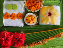 Spa. Tropical flowers towel clouse-up on green leaves coconut fruits Stock Photo