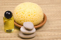 Spa accessories. Massage oils, zen stones and sponge - spa accessories royalty free stock photography