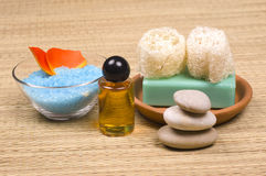 Spa accessories. Massage oils, zen stones, bath salt, soap and sponges - spa accessories royalty free stock images