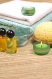 Spa accessories. Massage oils, aromatic balls, candles, towels and sponges  - spa accessories Royalty Free Stock Photography