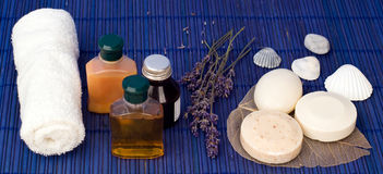 Spa accessories. Bath olis, soap, towel and aromatic lavender bunch Royalty Free Stock Photography