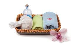Spa accessories in basket. Studio shot of spa accessories in basket, isolated on white Stock Photos