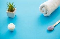 Spa Accessories. Bath Salt Beauty Treatment on Blue Background. Spa Accessories. Bath Salt Beauty Treatment on Blue Background Royalty Free Stock Image