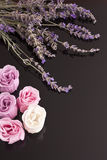 SPA accessories lavender with rose soap. On black mirror Royalty Free Stock Images