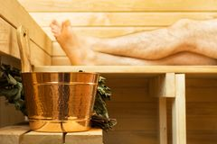 Spa accessories in sauna. Man on background Stock Photography