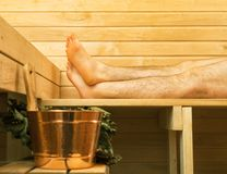 Spa accessories in sauna. Man on background Royalty Free Stock Photo
