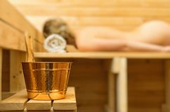 Spa accessories in sauna. Woman on background Royalty Free Stock Images