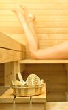 Spa accessories in sauna. Woman on background Royalty Free Stock Photography
