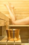 Spa accessories in sauna. Woman on background Royalty Free Stock Image