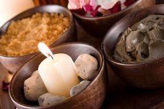Spa accessories: scented stones, mud, body scrub Stock Images