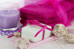 Spa accessories, towels, soap and candles. Spa accessories, towels, soap with a ribbon and candles Royalty Free Stock Image