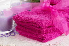 Spa accessories, towels, soap and candles. Spa accessories, towels, soap with a ribbon and candles Stock Image