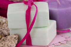 Spa accessories, towels, soap and candles. Spa accessories, towels, soap with a ribbon and candles Royalty Free Stock Images