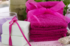 Spa accessories, towels, soap and candles. Spa accessories, towels, soap with a ribbon and candles Royalty Free Stock Photos
