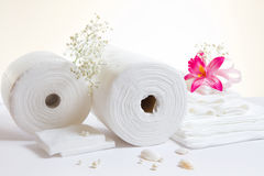 Spa accessories: white sheets and towels Royalty Free Stock Images